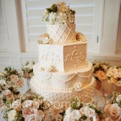 Bouquets surrounded the four-tiered cake, which was decorated with the couple's monogram and a matching flower topper.