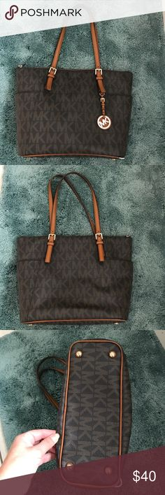 Authentic Michael Kors Jet Set Signature Purse Used, beautiful MK purse.  Signs of wear.  Needs some repair. (See pictures) Michael Kors Bags Shoulder Bags