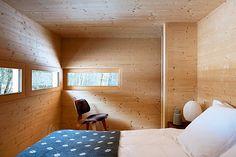 Cozy minimal wooden bedroom.