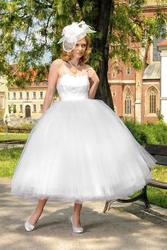 The head piece is ridiculous!  However, the dress is adorable!