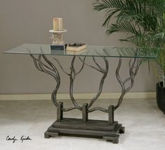 Esher, Console Table; Hand forged bronze metal shaped in a delicate twig design beneath clear, tempered glass 54 W X 36 H X 15 D (in) 103 lbs.