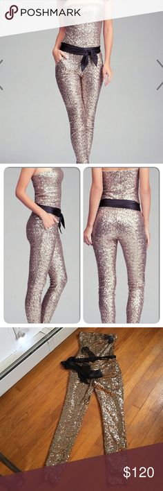 Babe sequence jumpsuit Gold sequence jumpsuit. Kipper in back with satin belt. Can be worn with or without straps. Tags say item is petite. Inseam is 27 inches bebe Pants Jumpsuits & Rompers