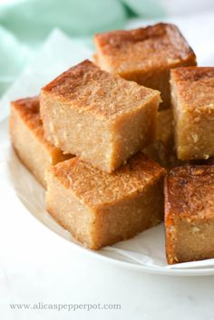 """Cassava pone has a dense and gummy texture which does not resemble what one would think of when they hear """"cake."""" The cassava root itself is very starchy.Love it gone to bed it eat so good. Yuca Recipes, Banana Bread Recipes, Baking Recipes, Cake Recipes, Dessert Recipes, Trinidadian Recipes, Guyanese Recipes, Jamaican Recipes, Carribean Food"""