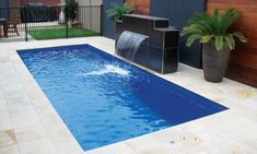 Small Palladium Plunge Fiberglass Pools With a sheer Descent Water feature.