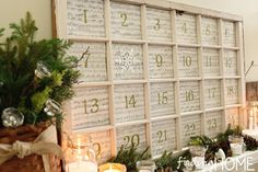 Christmas Mantel Advent Calendar made from an old window by Finding Home - so cool! #12daysofchristmas