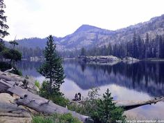 Hiking from Meeks Bay to Crag Lake in Desolation Wilderness, Lake Tahoe. The lake is like a mirror reflecting the mountains and towering pine trees. One of the best hikes near San Francisco.