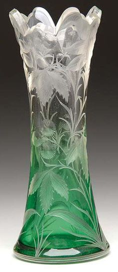 A Moser engraved vase, green glass shading to clear with an allover engraved floral decoration, Czechoslovakia, circa 1893-2005