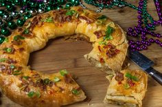 Cheese-stuffed boudin regally encased in crusty pepper jelly-glazed bread -- the king of all cakes.