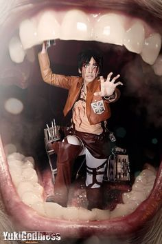This has to be one of the best cosplay photos I've ever seen. Attack on Titan, Eren Jeager in the mouth of a Titan<<except for eren was missing a leg...