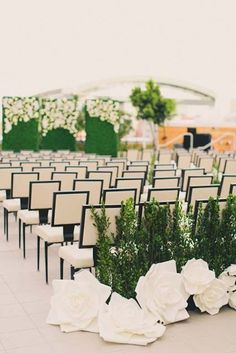 Classically Stunning Arizona Wedding - MODwedding.  Modern wedding ceremony.  white ceremony.  Greenery at ceremony.  Hedge wall backdrop.