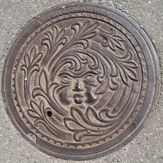 Manhole cover in Calgary - by elmoraux via Flickr -