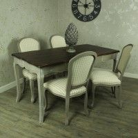 Large Grey Dining Table with 4 Padded Dining Chair - French Grey Range - Our French Grey bedroom furniture range boasts beautiful ornate brass handles, which compliment the hand painted grey facade of each piece. The tops are either varnished in a stunning dark wood, and lightly distressed, or lined with fabulous, vintage style cream, and grey striped linen The French Grey range is perfect for those who has more, rustic looking homes, create a beautiful look