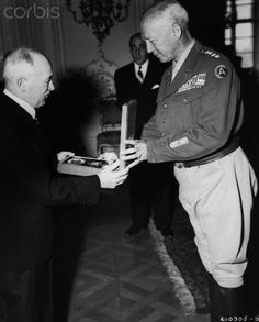 General George Patton, commander of the U.S. Third Army, is presented with the Order of the White Lion and the Military Cross, First Class, by Czechoslovakia President Edvard Benes. 1945.