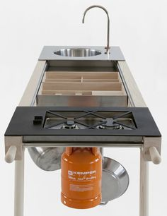 The Critter portable kitchen makes food prep and cooking an ease. Space can be reconfigured to meet the cook's needs.