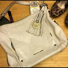 Michael Kors Bag Big and beautiful MK bag! She is a beauty!    2 pockets on front of bag.   1 large zip pocket inside 4 open pockets inside 1 key hook inside.  Inside is in excellent condition.  Bag is preloved and does show signs of wear. Leather is creased and some parts faded. Last pictures shows flaws including small stain in top right.  Gold tone hardware  Size Approx: 13x4x12 Michael Kors Bags Hobos