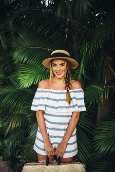 Image Via: Bloglovin' | black banded beach hats | off the shoulder lit blue and white romper | side braid