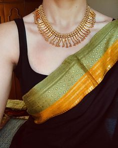 Black saree Green gold border Gold necklace - - Looking to shop sarees online? Check out these amazing Indian websites that have everything from heavy bridal sarees to regular everyday affordable sarees. Trendy Sarees, Stylish Sarees, Simple Sarees, Saree Blouse Patterns, Saree Blouse Designs, Lehenga Designs, Saree Jewellery, Silver Jewellery, Silver Rings