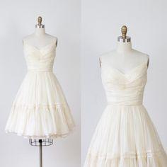 1950s vintage cream chiffon wedding dress. Ruched chiffon bodice with lining underneath. Spaghetti straps, full gathered skirt, ruffled hem with