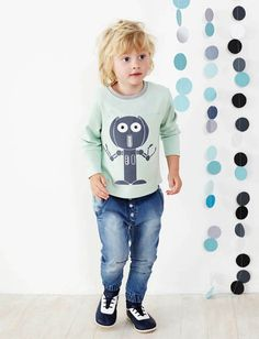 'I am a Robot'Long sleeve, loose fit tee made from soft 100% organic cotton knit fabric with curved back hem, contrast colour breast pocket and elbow patches. Machine washable. Available in aqua with 'robot' print.