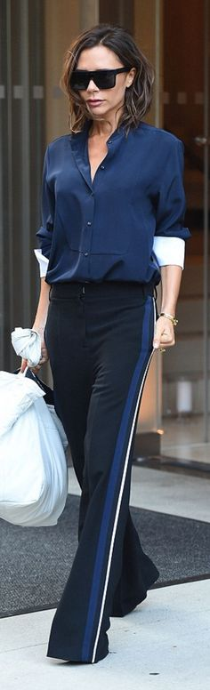 Who made Victoria Beckham's black sunglasses, blue collar top, and pants?