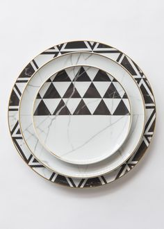 """An unexpected dinnerware line created by French designer Coline le Corre. A  refined, geometric approach, inspired by the noble marble of Carrara.    DIMENSIONS     * Charger Plate (13"""")     * Dinner Plate (11"""")     * Salad/Dessert Plate (8.6"""")     * Bread Plate (6.4"""")     * Soup Bowl (9.9"""")     * Cereal Bowl (6.3"""")     * Cup/Saucer Duo  DETAILS     * Porcelain / Gold        * Made in Portugal by Vista Alegre     * Not suitable for microwave. For dishwashing we advise short cycles…"""