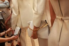 Clutch adjustments before the Calvin Klein show at 205 West 39th Street.  Photo: Hiroko Masuike/The New York Times