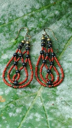 Rust and black woven earrings by artifactsbyclare on Etsy, $30.00