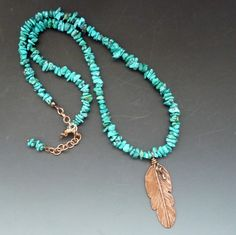 Turquoise And Copper Feather Necklace  A southwestern copper feather necklace design. The feather is 2 3/4 inches long and about 1 inch wide. The feather was cut out from copper sheet metal then textured. I added a lacquer finish to protect the metal. The feather is hung from a Turquoise beaded necklace to compliment the feather pendant. The necklace measures 22-24 inches with a copper hook clasp and extender chain. Each piece is unique, handmade and no two pieces will be exactly alike. ...