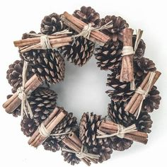 Handmade Pine Cone Wreath with decorative Cinnamon Sticks. Perfect for a door, table centre or hearth. Acorn Crafts, Pine Cone Crafts, Pine Cone Decorations, Christmas Decorations, Christmas Ornaments, Holiday Wreaths, Holiday Crafts, Stick Wreath, Christmas Fairy