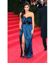 @Who What Wear - Kim Kardashian Lanvin custom two-tone black and pétrol blue draped strapless dress in satin duchesse with black satin belt and black grosgrain cage evening sandals; Lorraine Schwartz 10 million dollar platinum diamond drop earrings and her own diamond engagement ring.
