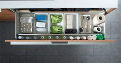 SANTOS kitchen | Organising cleaning utensils     Sink unit with an upper drawer for storing and organising cleaning utensils.