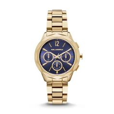 Optik Gold-Tone Multifunction Watch Karl's signature faceted case adds an edgy, feminine feel to the gold-tone Optik watch. The navy sunray dial is accented with gold-tone indexes, hands, and subdials, and complemented by a three-link bracelet.