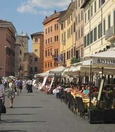Street scene in Rome, Italy 2010 - why don't we have outdoor restaurants like this here in the U.S. ?  They are wonderful !!!