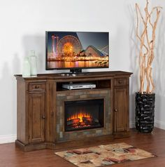 """Transform any room in your home into a warm, cozy retreat with the Cambridge 72"""" TV stand with log firebox. Poplar and walnut woods create a sturdy place for TVs up to 72"""" to rest, while the antique charcoal finish and hammered-metal hardware present a genuine rustic look. The fireplace offers zone heating, as well as multiple brightness and temperature settings to create your own chalet experience. Plus, a cool-to-touch outside makes this an excellent family-safe option for your living…"""
