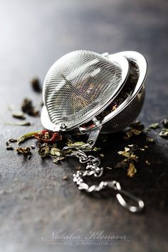 Tea composition with tea strainer on dark background