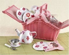"""Pink Tin Tea Set, complete with pink basket by Delton Products. $34.99. This deluxe version of the popular toy Tin Tea Set also includes a durable, plastic wicker basket, perfect for easy storage! Set includes 4 plates, 4 cups, 4 saucers, 4 spoons and a teapot with lid. This tin tea set is very old fashioned. Just like Grandma used to play with! The plates are about 3.5"""" in diameter and the saucers about 2""""."""