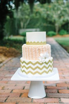 Pink and gold wedding cake with chevron and ruffle layers | Classic Southern Charleston Wedding At Dunes West Golf & River Club | Photograph by Aaron and Jillian Photography  http://storyboardwedding.com/southern-charleston-wedding-dunes-west-golf-river-club/