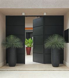 A sleek and minimalist aesthetic with some tonal foliage makes this entranceway…