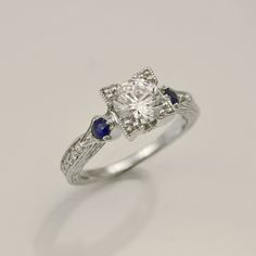 Vintage inspired engagement ring from Carizza with sapphire accents and pave diamonds.  Matching band also available at Morgan's Treasure.