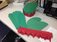 Elf hat. Construction paper  a poster board head band and one jingle bell at the top for authenticity.