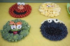 Sesame Street faces made from broccoli, tomatoes, blueberries, and pineapple. Funny.