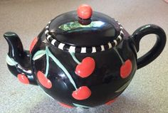 Mary Engelbreit Small with Red Cherries Black Teapot 1997    I have this one as well....