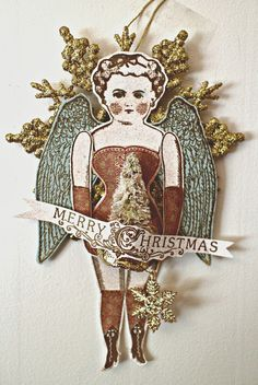 Made by Laura Turner using Character Constructions Doll stamp and Mad Rat Rubber wings.