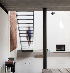 UV House is a minimalist house located in Varese, Italy, designed by OASI architects. UV house is a project for a young couple, conversion of an old industrial building into a modern urban villa. (9)