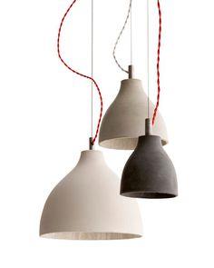 Heavy Light designed by Benjamin Hubert. Industrial style cast-concrete pendant lights.