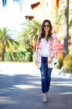 Street Style: 26 Ways to Style a Kimono for Spring -feminine watercolor floral kimono styled with a casual white top + distressed denim and a white crossbody bag.