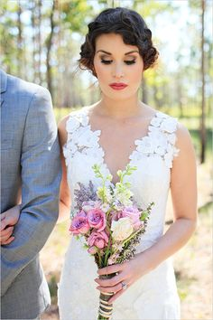 Ooooh, loving the strong makeup with the messy updo against the laser cut-out feature of the dress