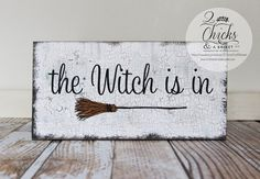 The Witch Is In Sign  This sign measures 6x12 inches. All of our signs are handcrafted by us from start to finish. We cut the board to size,
