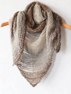 "How To Knit An Easy Triangle Shawl in garter stitch or garter and dropped stitches if you like it airy.  Use ""Shawl"" yarn, worsted weight."