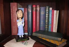 Jane Austen booblehead guarding her collection ... <3 it! I have a bobble head of my own.